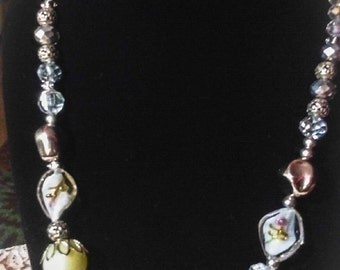 White and silver eclectic necklace with such unique and different beads