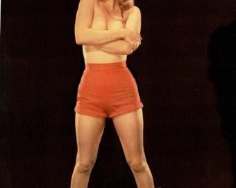 Marilyn Monroe Caught Short (braless, that is) in a early Calendar Pose