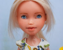 Makeunder bratz doll. Unique handpainted face, blonde hair with long bangs, blue eyes, handmade doll clothes and shoes