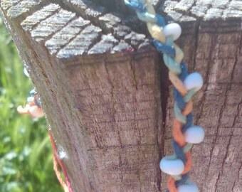 Bracelet braided multi-colored hemp thread and white glass pearls