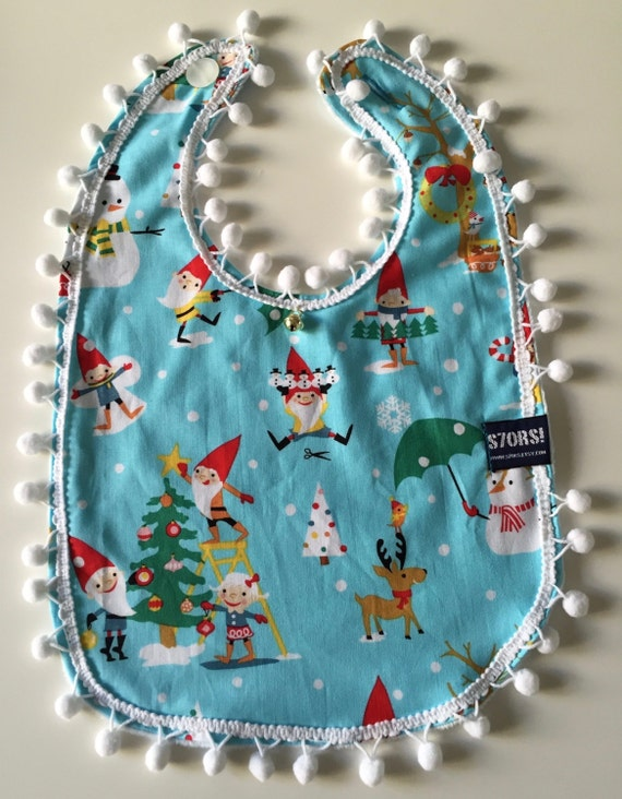 Gnomes christmas extra-large baby bib. Double sided with snowballs and a little bell. Ideal for the first bites and baby-led weaning.