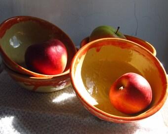Red and yellow ceramic bowl set