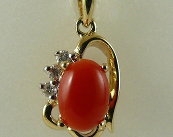 Italian Coral 7.1mm x 5mm Pendant with Diamonds 0.05ct 14k Yellow Gold