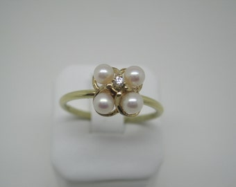 Vintage gold pearl and diamond ring