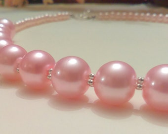 Pink Glass Imitation Beaded Pearl Necklace With Heart Toggle Clasp.
