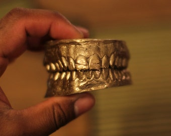 Human teeth cast oddity. Both upper and lower sets. dental. Gold or black colour.