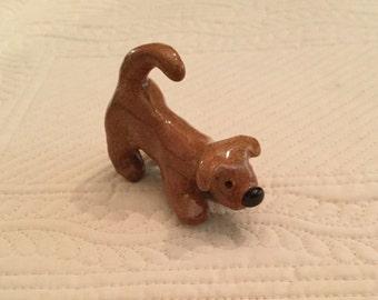Playful dog scupture