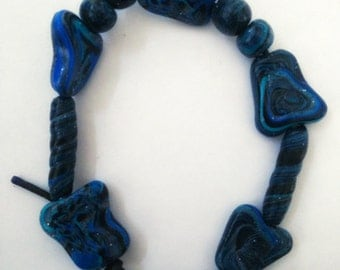 Bracelet made of polymer clay items