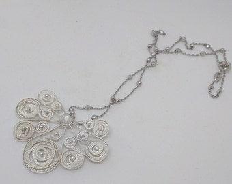 Silver filigree pendant with moonstone
