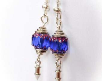 Elegant earrings with indigo blue glass beads and silvery bead caps and charms