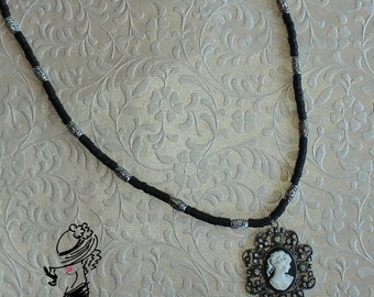 Black beaded cameo necklace