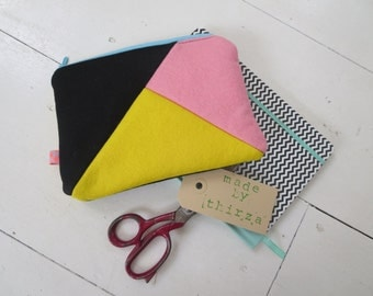 Hand made pouch of wool felt, pink and yellow