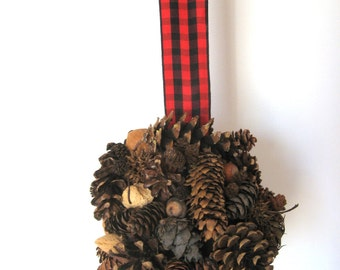 Pine cone kissing ball with nuts and buffalo plaid ribbon for wedding pew decoration, rustic home decor, or Christmas decor