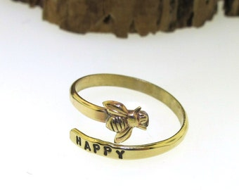 Be Happy Bee Ring, adjustable hand stamped jewelry in yellow brass, gold tone ring by Kathryn Riechert