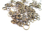 Brass Plated Jump Rings, 10 grams of assorted size and gauge jump rings (125-200 pieces) C231