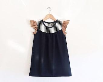 girls black cotton dress with stripe detail