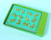 12 pc gold bow push pins
