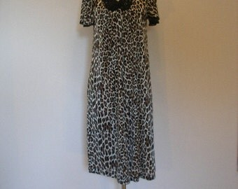 70s leopard print robe. Lace bodice, tiny fabric covered buttons, slinky nylon retro animal print robe. S-M.