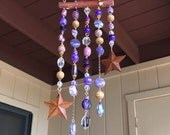 Suncatcher with Purple Beads, Crystals, and Rusty Tin Stars