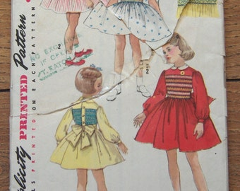 vintage 50s simplicity pattern 25 childs dress with smocking sz 3 uncut