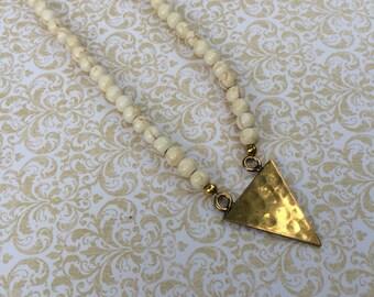 Hammered brass triange pendant
