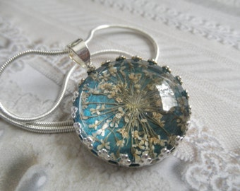 Peace-Queen Anne's Lace Pendant Beneath Glass Atop Rich, Glowing Teal Background Pressed Flower Crown Pendant-Symbolizes Peace