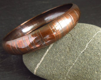Curved copper bangle, synclastic form, stripe texture, metalwork bangle, oxidized finish, copper wedding anniversary gift, 7th anniversary