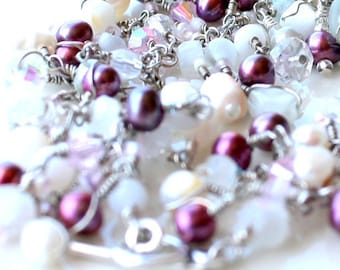 fields of raspberry pearls. bracelet. layered. white moonstone and assorted beads wire wrapped.