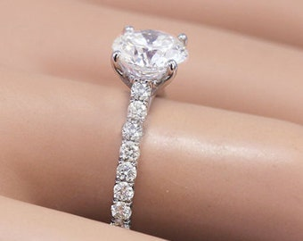18K White Gold Round Cut Forever One Moissanite and Diamond Engagement Ring Prong Set 1.50ctw