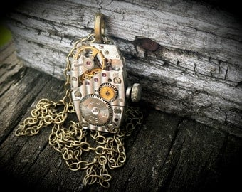 Oblong Steampunk Inspired Pendant with Swarovski Crystal, Cogs, Gears and Ruby jewels