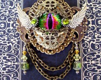 Dragon Eye Brooch (P606) - Prism Green Purple Glass Eye - Antique Brass Hardware - Crystal Dangles - Silver Wings - Pin Fastener Bail Loops