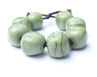 Leafy green striations lampwork bead set - 8 curvy cube lampwork beads