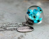 Turquoise real flowers in resin sphere. Silver ox necklace, cap and FORGET ME NOT charm. Floating flower necklace.