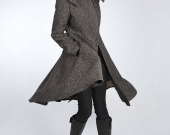 Elegantly Dramatic Coat with Versatile Collar and Flared Skirt. This Coat is Lined and has Side Seam Pockets and Three Snap Closure