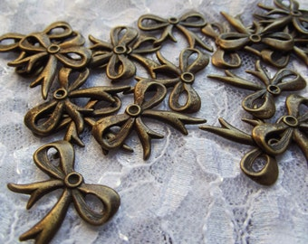 19 vintage antique gold bow embellishments / metal finding / altered art / Jewelry Supplies / Mixed Media Supplies / Assemblage supply / DIY
