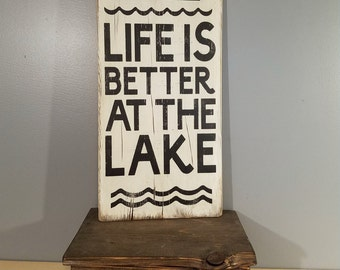 Life is Better at the Lake, with boat.  Rustic Wooden Hand Painted sign. White with Back lettering.