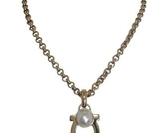 Vintage Salvatore Ferragamo white faux pearl and golden gancini necklace. Ferragamo classic jewelry piece