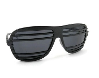 Retro Black Sunglasses with Slotted Bars Across the Lenses