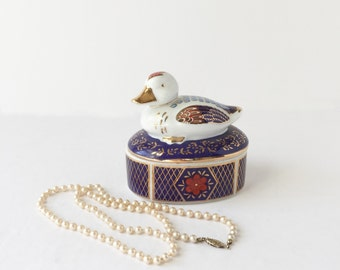 Vintage Porcelain Duck Trinket Box Jewelry Box Vanity Storage Jewelry Storage Duck Figurine Red White Blue Gold Accents Duck on a Basket