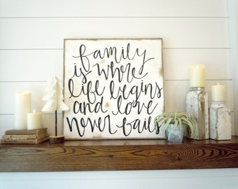 Family is where life begins and love never fails black and white rustic wood sign