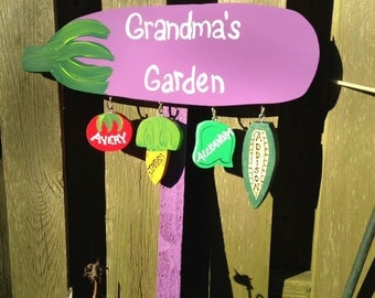 Personalized grandparent garden sign in the shape of an eggplant with personalized hanging grandchildren