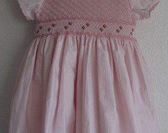 Gorgeous pink smoked dress, Puffy short sleeves, fully line bodice, Hand embroidered pink baby dress.