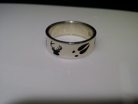 Sportsman's ring, Duck band. Deep cut and back filled engravings