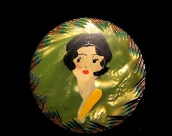 Adorable Art Deco 1920s celluloid flapper brooch