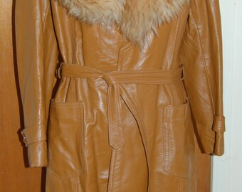 1960's leather coat with fur collar. Very cool. Great condition. Hippie boho
