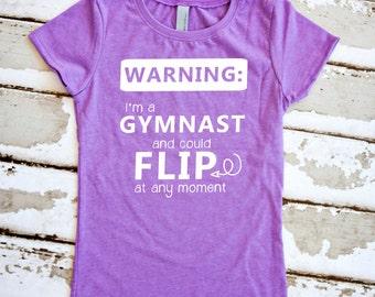 Gymnastics Shirt - Warning: I'm A Gymnast and Could Flip at Any Moment - Purple Girls T-Shirt