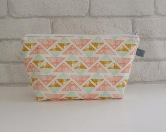 Makeup bag in geometric triangle fabric