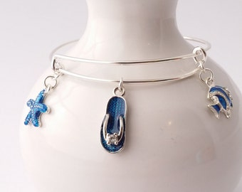Beachy Blues bangle bracelet featuring blue starfish, flip flop sandal and angel fish charms