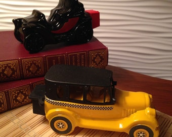 Two Avon cologne bottles - 1926 Checker Cab and Electric Charger