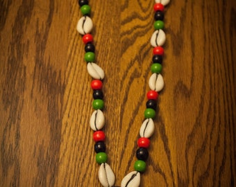 Africa Pendant on Cowrie Shells and RBG Beads